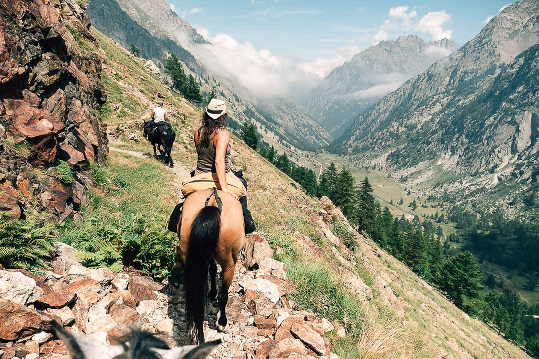 Rider on an adventure horseback trail in the mountains