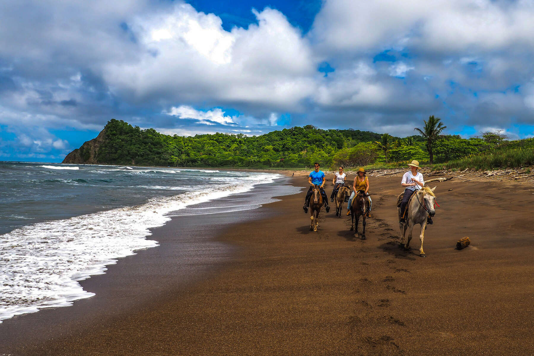 Riders enjoying a beach trail ride in Costa Rica