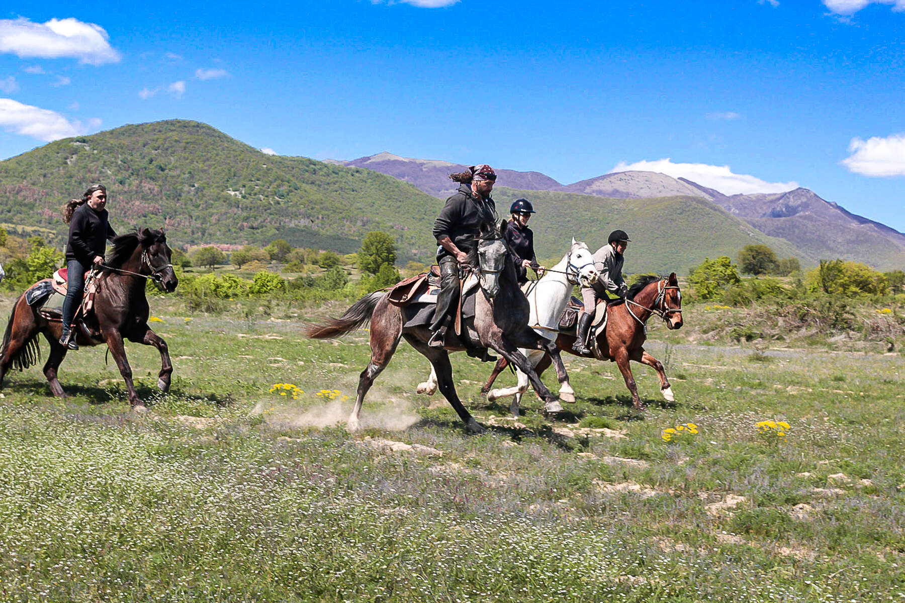 Riders enjoying a canter in Bulgaria