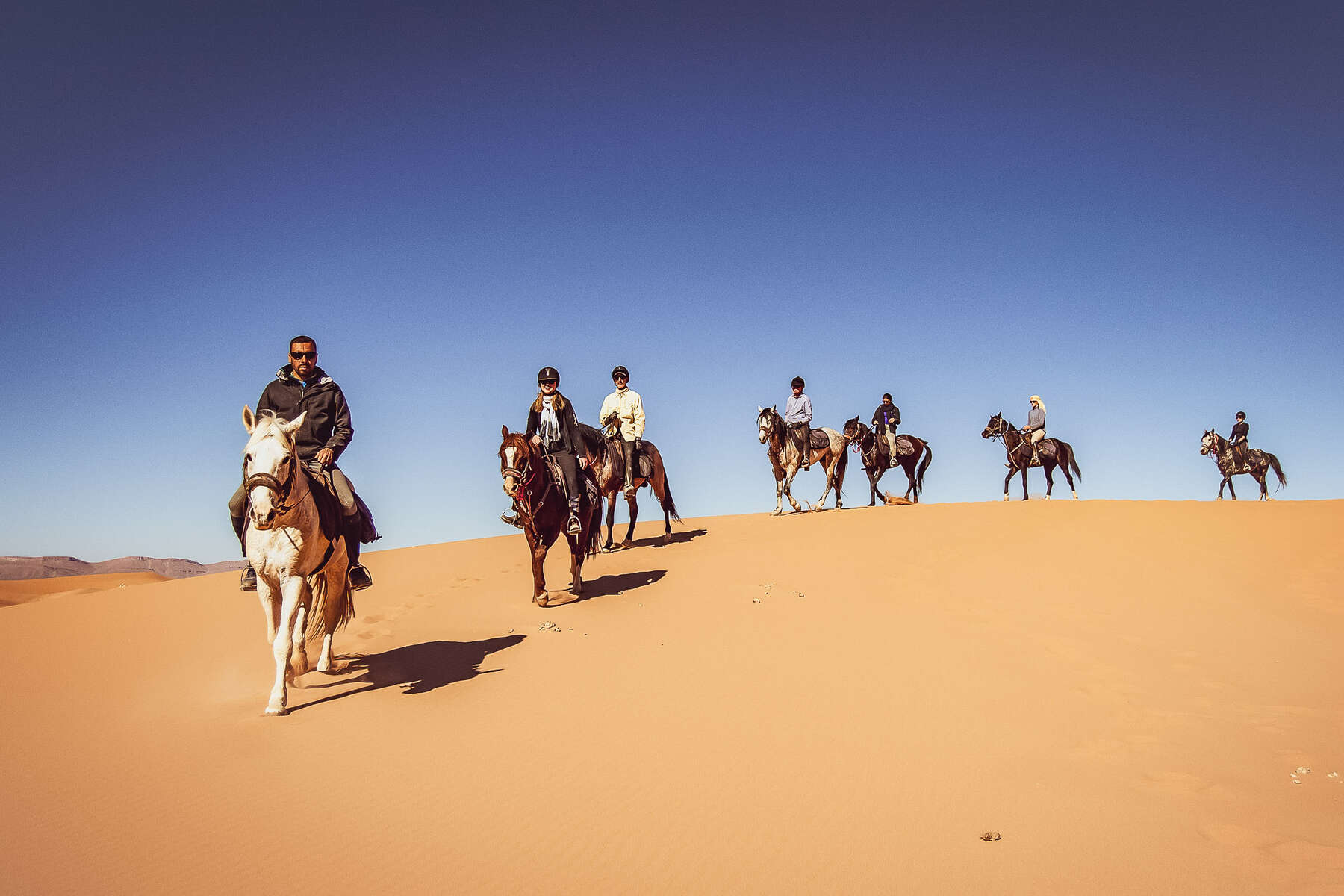 Riders in the dunes near Merzouga, Morocco