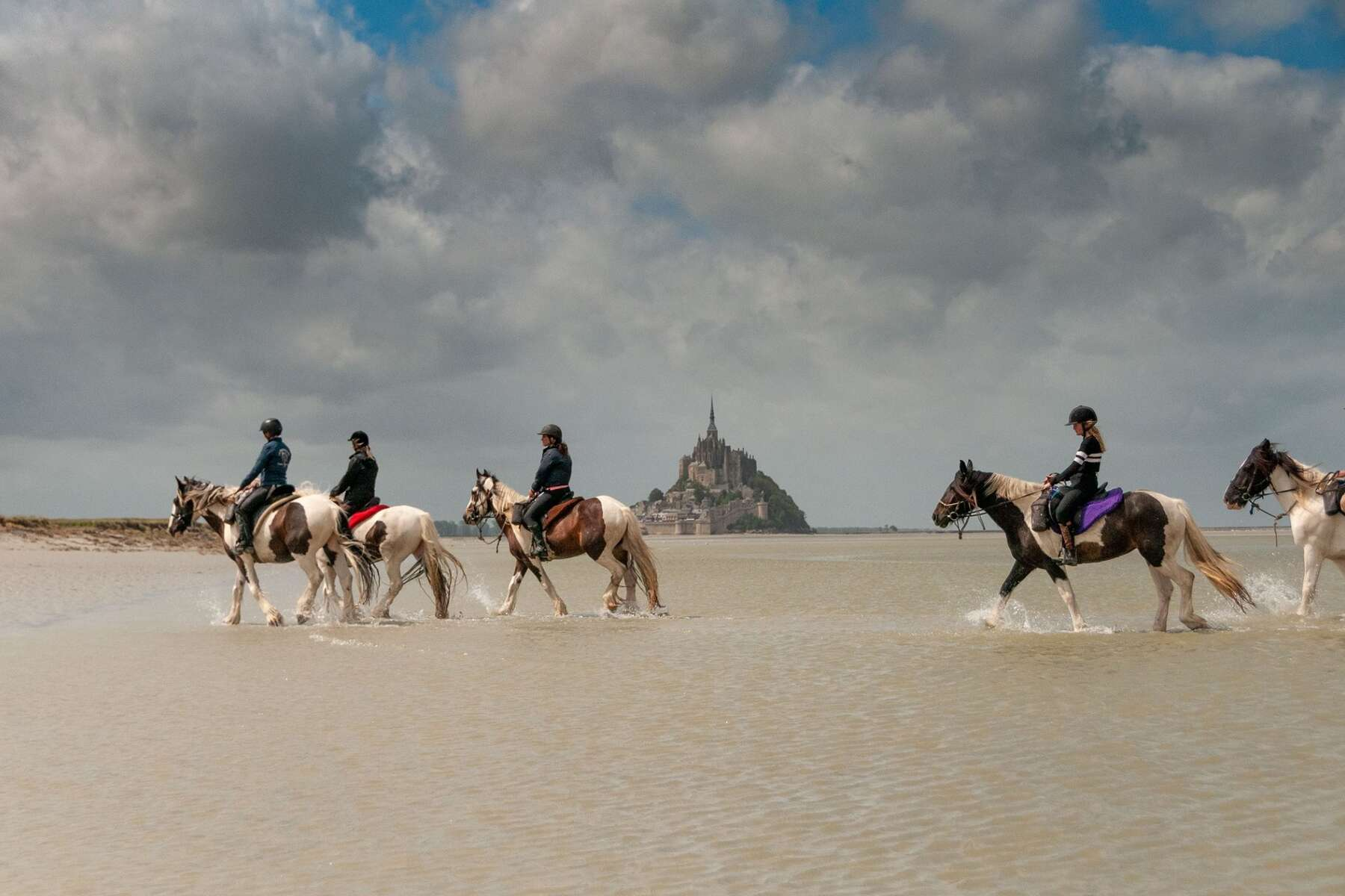 Riding with the Mt St Michel in the background, France