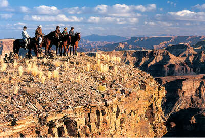 Fish River Canyon and horses in Namibia