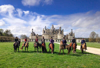Group of riders on a trail to Chambord castle and the castles of the Loire Valley