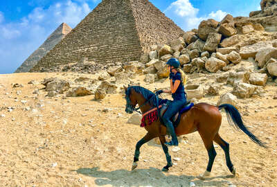 Horse and rider near Cairo, the Great Pyramid of Giza