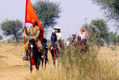 Horses and riders in indian desert