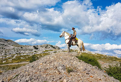 Rider overlooking the views in the Velebit natural park