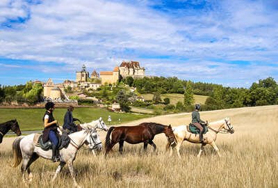 Riders riding in front of medieval castles in France