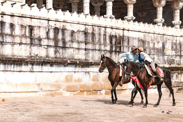 A couple on horseback in Rajasthan on a trail riding holiday