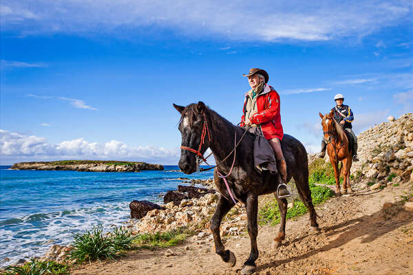 A group of trail riders riding Menorcan horses on a riding holiday in Menorca