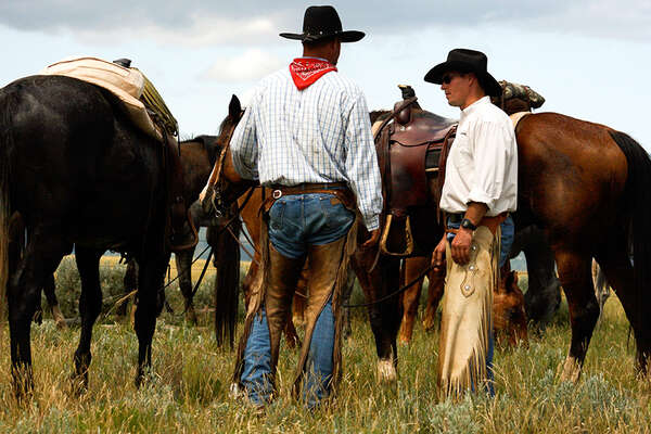 Authentic cowboys in Montana during a cattle drive