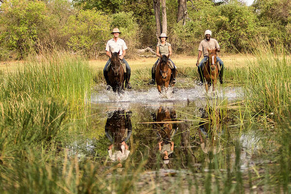 Botswana and riders in the Okavango Delta