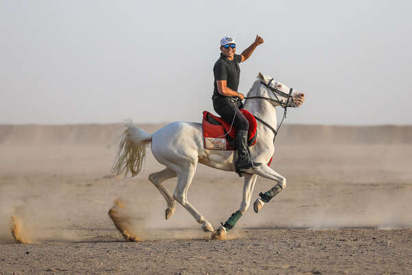 Cantering on a horse in a desert in Egypt