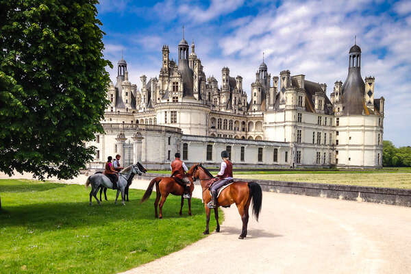 Chambord castle and horseback riders