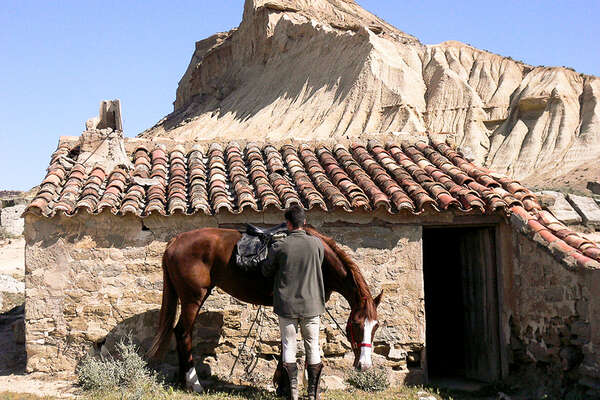 Fortified villages and horses in Spain