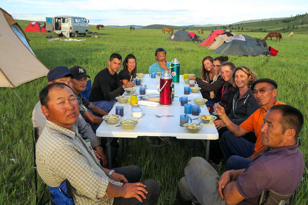 Group of horseback riders getting ready for dinner in Mongolia