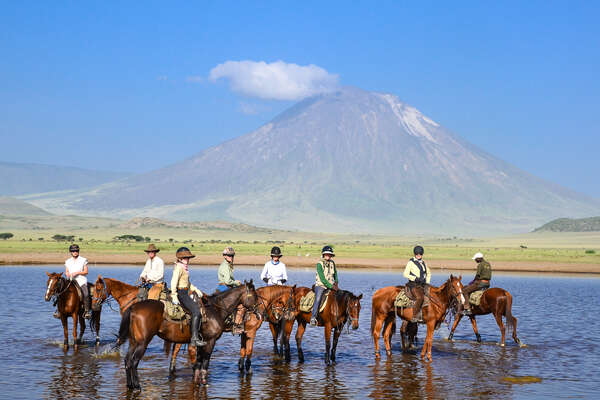 Group of horseback riders on a trail riding holiday in Tanzania