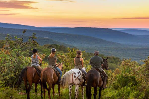 Group of riders admiring the sunset at Ant's Lodges, Waterberg in South Africa
