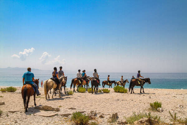 Group of riders arriving to the Ionian Sea