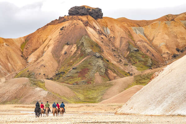 Group of riders on a riding holiday in the Landmannalaugar in Iceland