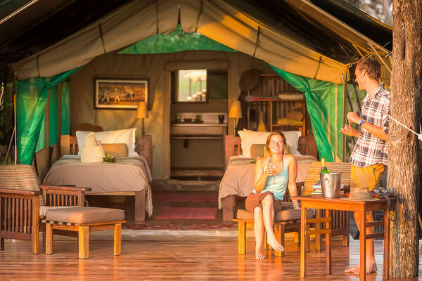Guests resting at Macatoo camp in Botswana