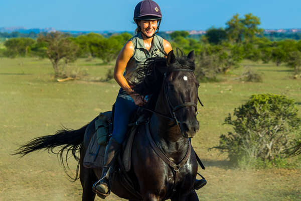 Happy rider on a horseback safari