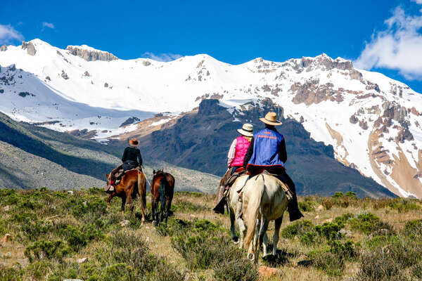 Horse and rider high up in the Andean mountains