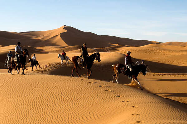 Horse riding trail in the Sahara Desert in Morocco