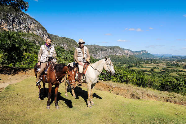 Horseback riders close to the mongotes in Cuba.
