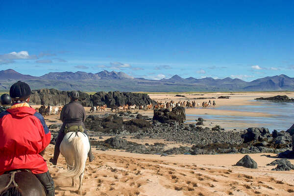 Horseback riders on a horse vacation in Iceland