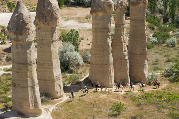 Horseback riders seen riding in the Love Valley of Cappadocia