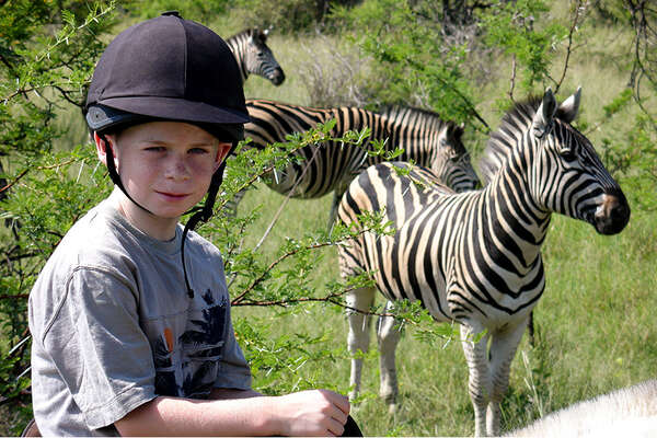 Horseback riding safari in South Africa with zebras
