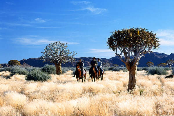 Horseback trail riding across Namibia