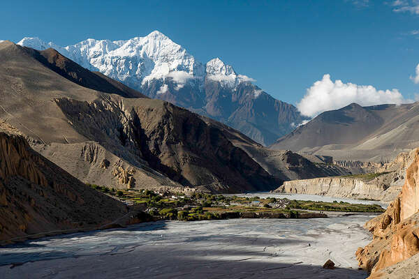 Mustang cliffs and Himalaya mountains