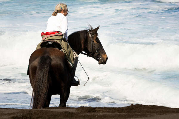 On horseback on Azores beach