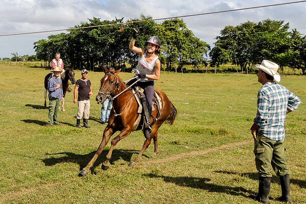 Participate in typical equestrian Cuban games.