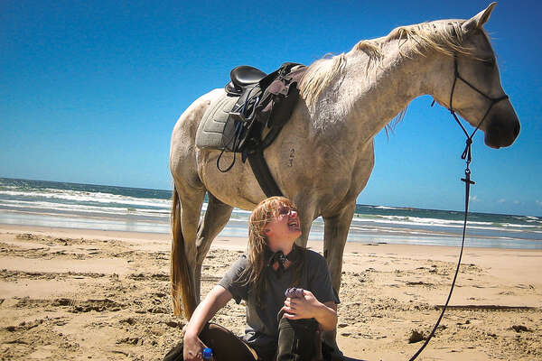 Rider and horse on a beach in Australia