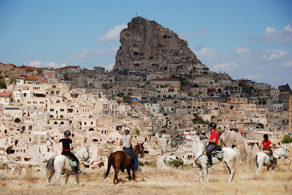 Riders and troglodyte villages in Cappadocia
