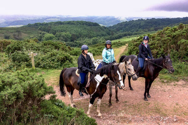 Riders enjoying horseback trails in Exmoor