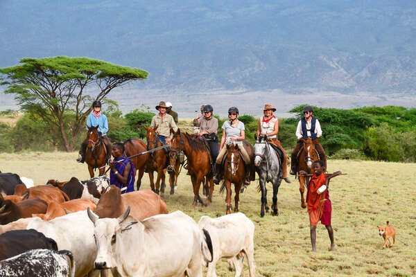 Riders following Masai farmers on a trail riding holiday