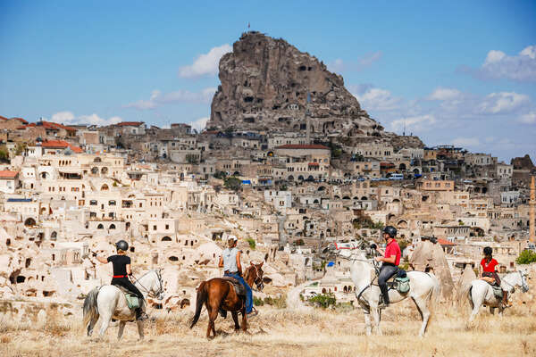 Riders in front of troglodyte villages in Turkey