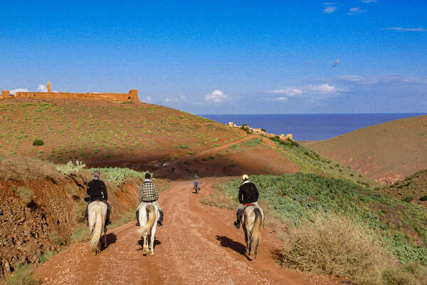 Riders in Morocco with a view of the Atlantic
