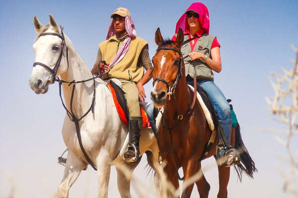 Riders in Oman