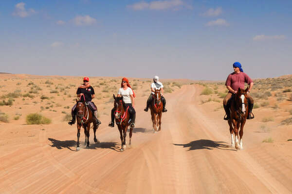 Riders in the Arabian Desert