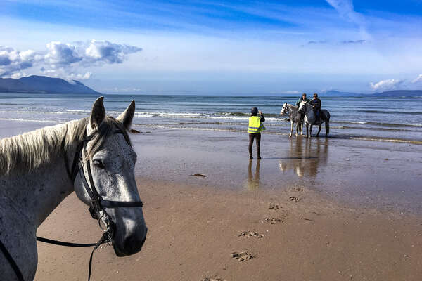 Riders on a beach in Ireland