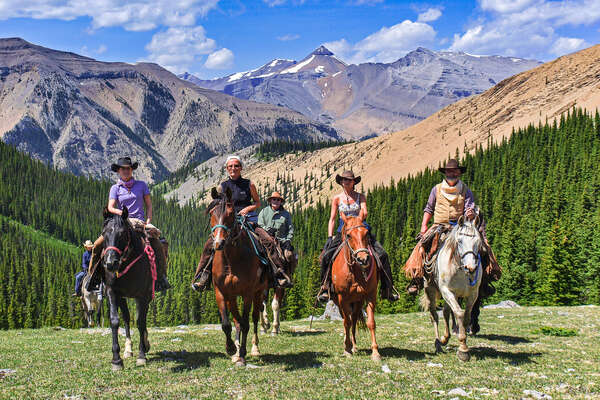 Riders on a pack trip adventure in Alberta