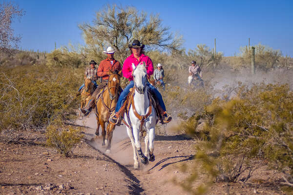 Riders on a trail ride at White Stallion ranch in Arizona