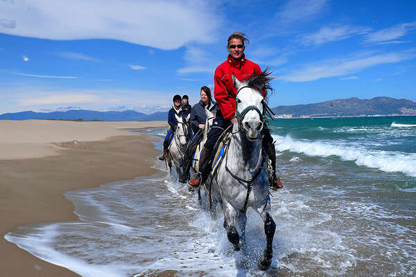 Riders on spain beach