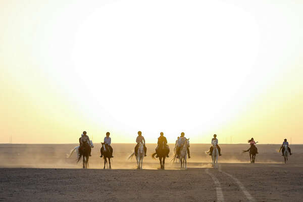Riders riding out into the sunset in Egypt