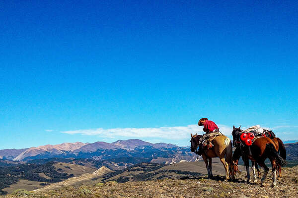 Riders with a view of the Andes in Patagonia