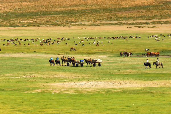 Riding across the steppe in Mongolia